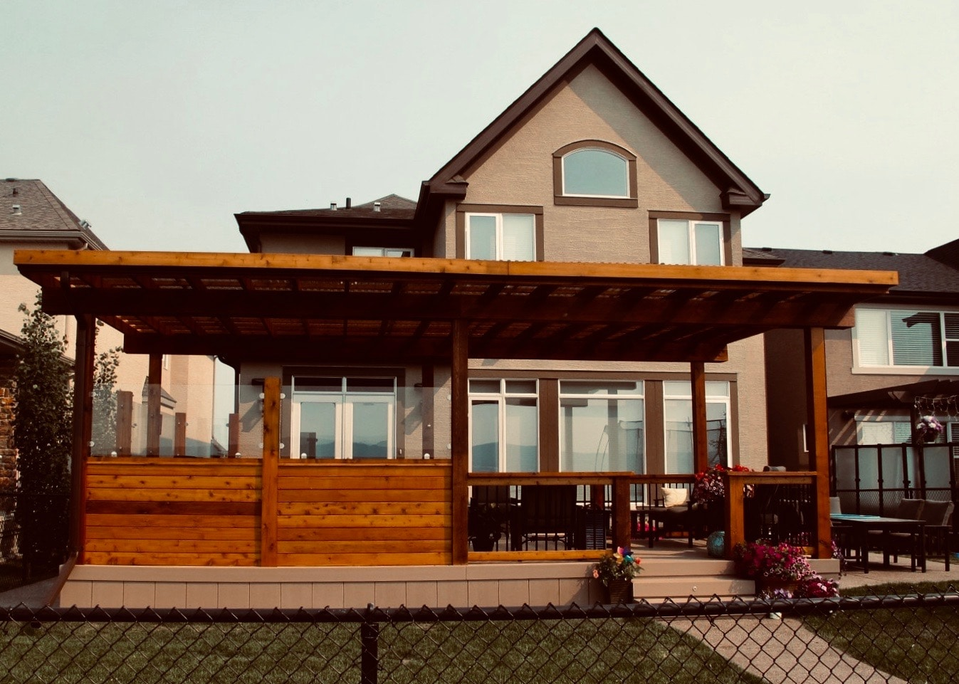 Pergola and deck combining both cedar decking and composite decking boards