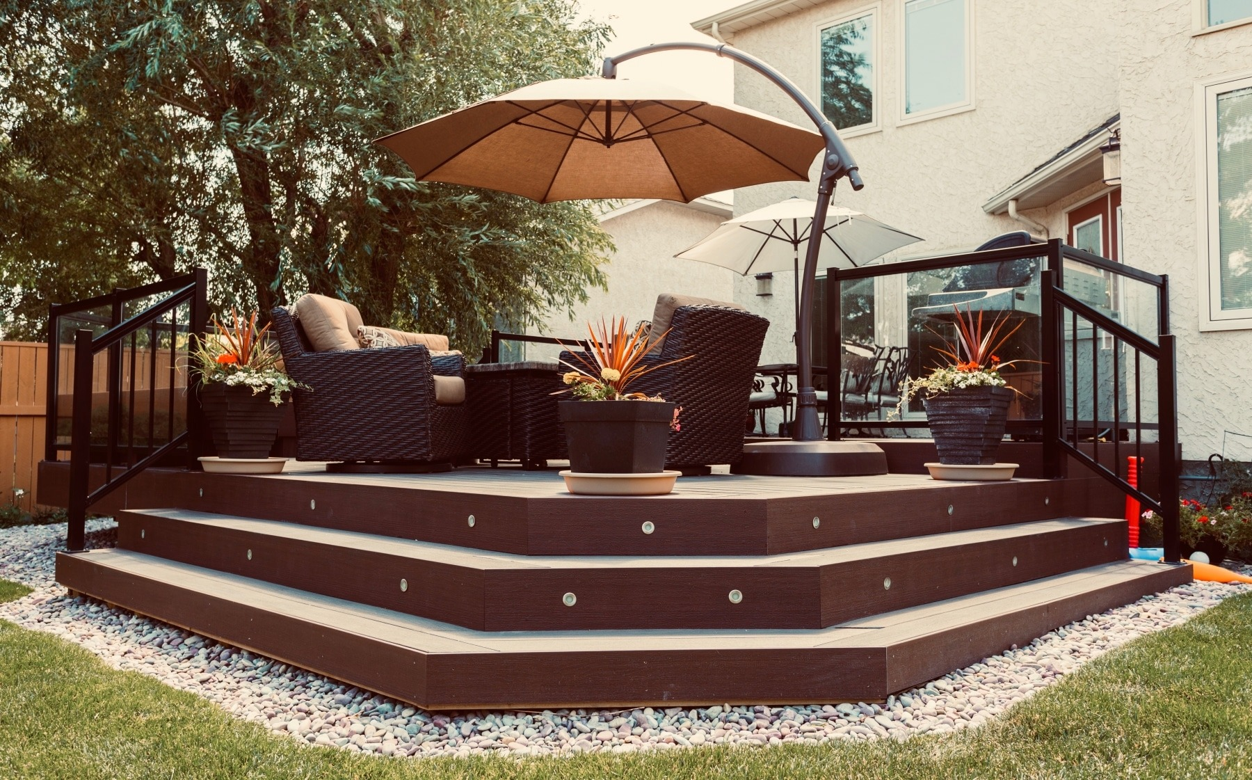 Low maintenance deck using composite deck boards and aluminum and glass railing
