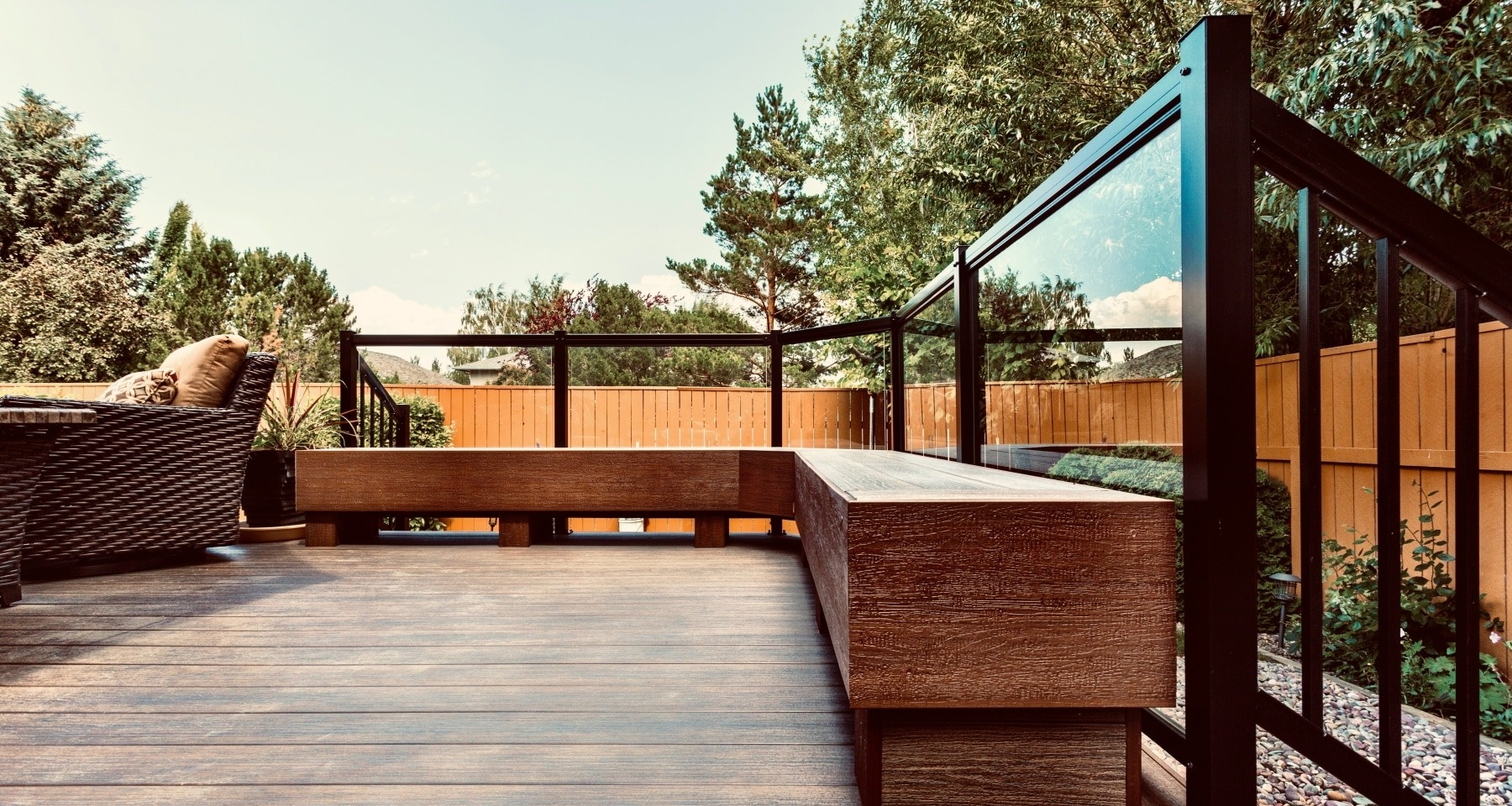 Composite deck with bench constructed from the same composite decking boards