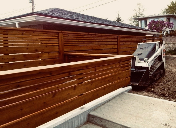 Modern fence design using different width boards